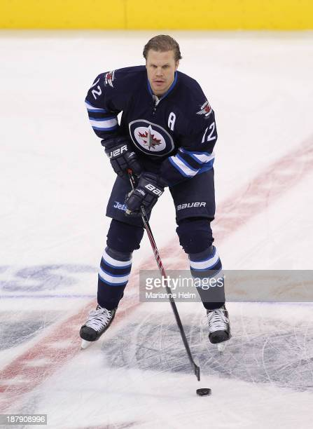 Olli Jokinen of the Winnipeg Jets skates before an NHL game against the Detroit Red Wings at the MTS Centre on November 4 2013 in Winnipeg Manitoba...