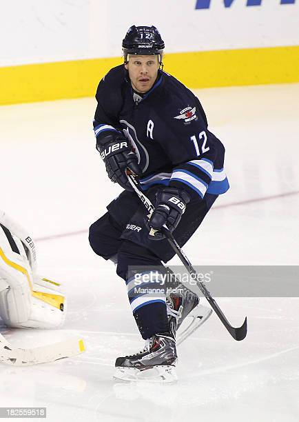 Olli Jokinen of the Winnipeg Jets skates down the ice during third period in an NHL preseason game against the Boston Bruins at the MTS Centre on...