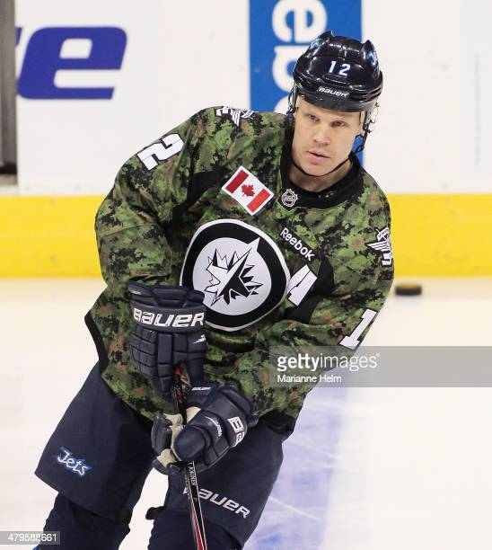 Olli Jokinen of the Winnipeg Jets skates down the ice during warmup before an NHL game against the Ottawa Senators at the MTS Centre on March 8 2014...