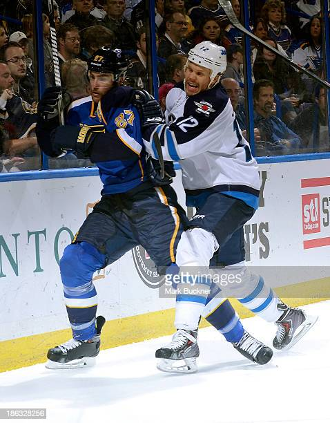 Olli Jokinen of the Winnipeg Jets slams into Alex Pietrangelo of the St Louis Blues on October 29 2013 at Scottrade Center in St Louis Missouri