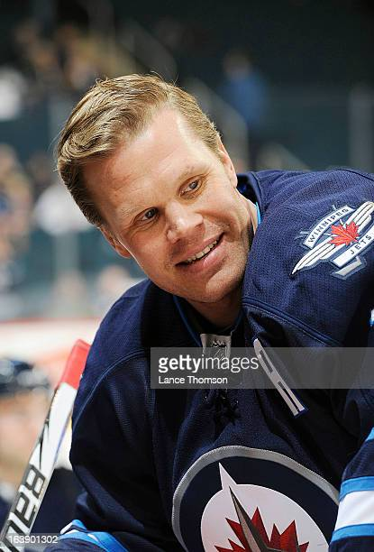Olli Jokinen of the Winnipeg Jets smiles as he takes part in the pregame warm up prior to NHL action against the Toronto Maple Leafs at the MTS...