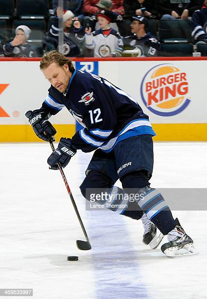 Olli Jokinen of the Winnipeg Jets takes part in the pregame warm up prior to NHL action against the Florida Panthers at the MTS Centre on December 20...