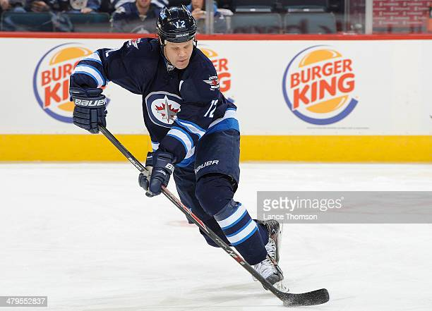 Olli Jokinen of the Winnipeg Jets takes part in the pregame warm up prior to NHL action against the Los Angeles Kings at the MTS Centre on March 6...