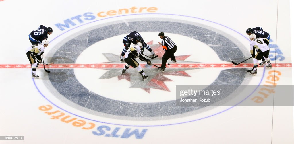 <a gi-track='captionPersonalityLinkClicked' href=/galleries/search?phrase=Olli+Jokinen&family=editorial&specificpeople=202946 ng-click='$event.stopPropagation()'>Olli Jokinen</a> #12 of the Winnipeg Jets takes the opening faceoff of the second period against <a gi-track='captionPersonalityLinkClicked' href=/galleries/search?phrase=Sidney+Crosby&family=editorial&specificpeople=212781 ng-click='$event.stopPropagation()'>Sidney Crosby</a> #87 of the Pittsburgh Penguins at the MTS Centre on January 25, 2013 in Winnipeg, Manitoba, Canada.