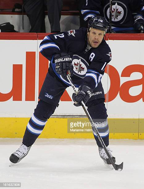 Olli Jokinen of the Winnipeg Jets watches the play during a game against the Toronto Maple Leafs in NHL action on February 7 2013 at the MTS Centre...