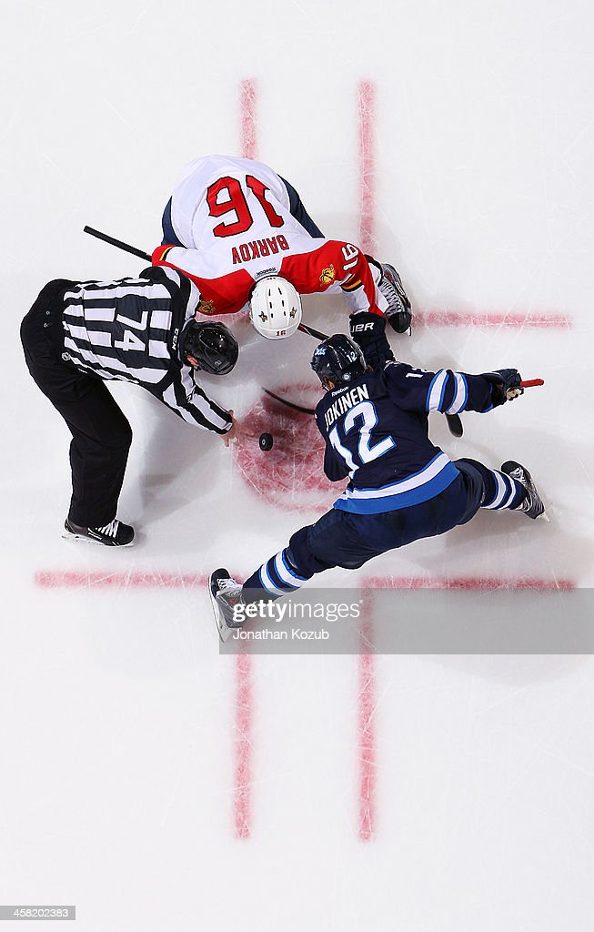 <a gi-track='captionPersonalityLinkClicked' href=/galleries/search?phrase=Olli+Jokinen&family=editorial&specificpeople=202946 ng-click='$event.stopPropagation()'>Olli Jokinen</a> #12 of the Winnipeg Jets wins a second period face-off against <a gi-track='captionPersonalityLinkClicked' href=/galleries/search?phrase=Aleksander+Barkov&family=editorial&specificpeople=8760147 ng-click='$event.stopPropagation()'>Aleksander Barkov</a> #16 of the Florida Panthers at the MTS Centre on December 20, 2013 in Winnipeg, Manitoba, Canada.