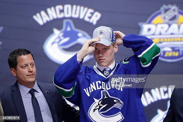 Olli Juolevi celebrates with the Vancouver Canucks after being selected fifth overall during round one of the 2016 NHL Draft on June 24 2016 in...