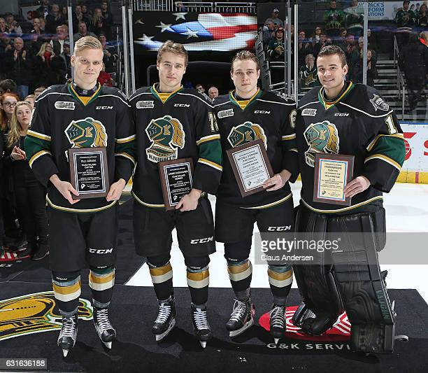 Olli Juolevi Janne Kuokkanen Mitchell Stephens and Tyler Parsons of the London Knights are honoured for their participation in the World Junior...
