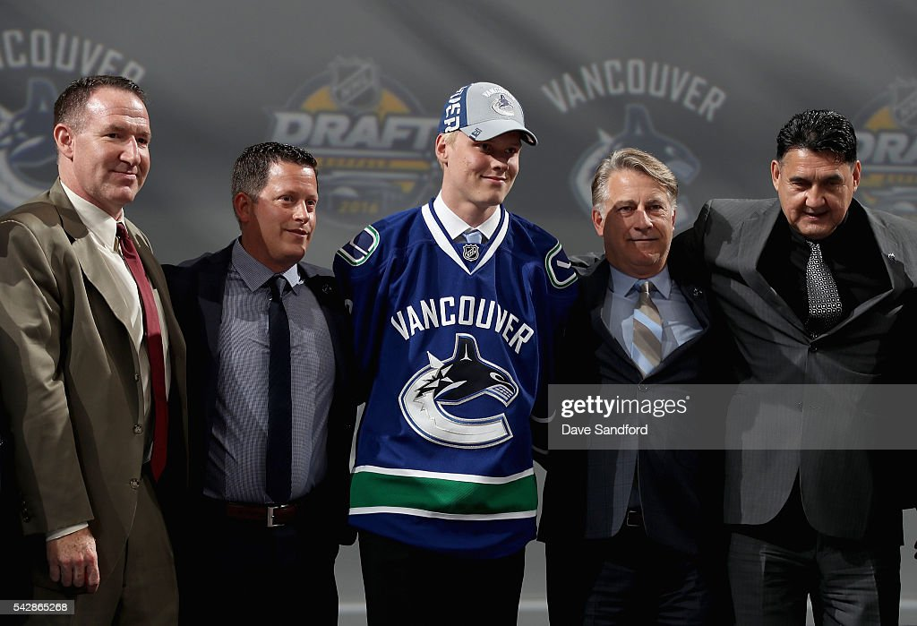 <a gi-track='captionPersonalityLinkClicked' href=/galleries/search?phrase=Olli+Juolevi&family=editorial&specificpeople=15073944 ng-click='$event.stopPropagation()'>Olli Juolevi</a> poses onstage with Vancouver Canucks team personnel after being selected fifth overall by the Vancouver Canucks during round one of the 2016 NHL Draft at First Niagara Center on June 24, 2016 in Buffalo, New York.