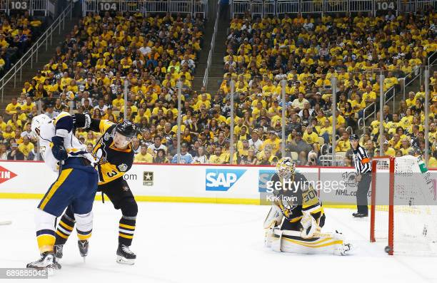Olli Maatta and Matt Murray of the Pittsburgh Penguins defend against Austin Watson of the Nashville Predators in Game One of the 2017 NHL Stanley...
