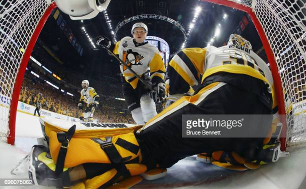 Olli Maatta and Matt Murray of the Pittsburgh Penguins skate against the Nashville Predators in Game Six of the 2017 NHL Stanley Cup Final at the...