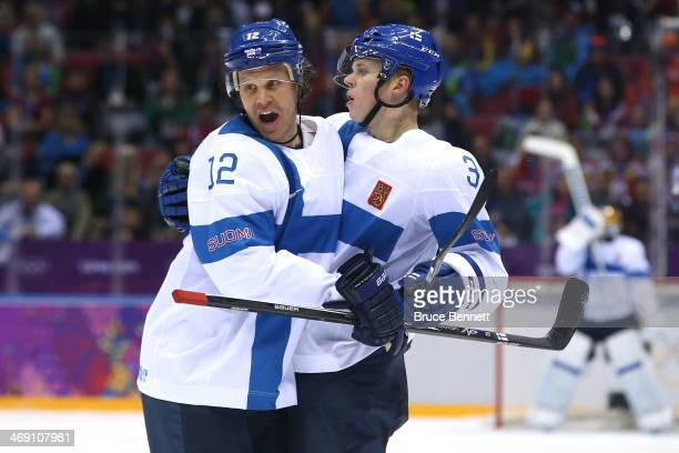 Olli Maatta of Finland celebrates with teammate Olli Jokinen after scoring a goal in the first period against Bernhard Starkbaum of Austria during...