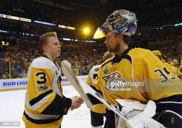 Olli Maatta of the Pittsburgh Penguins and Pekka Rinne of the Nashville Predators shake hands following the Penguins Stanley Cup winning victory over...