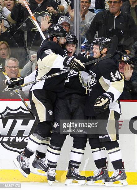 Olli Maatta of the Pittsburgh Penguins celebrates his first National Hockey League goal against the Vancouver Canucks during the game at Consol...
