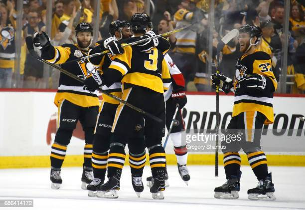 Olli Maatta of the Pittsburgh Penguins celebrates with his teammates after scoring a goal against Craig Anderson of the Ottawa Senators during the...