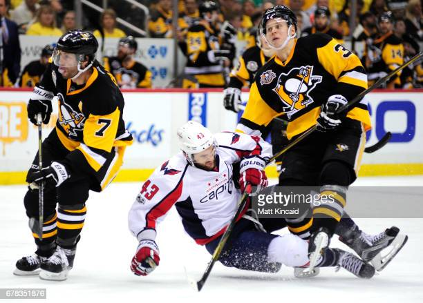 Olli Maatta of the Pittsburgh Penguins collides with Tom Wilson of the Washington Capitals in Game Four of the Eastern Conference Second Round during...