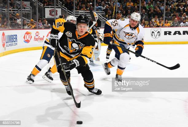 Olli Maatta of the Pittsburgh Penguins handles the puck against Cody McLeod of the Nashville Predators at PPG Paints Arena on January 31 2017 in...