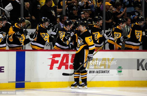 Olli Maatta of the Pittsburgh Penguins is congratulated by teammates after scoring a goal against the Nashville Predators at PPG PAINTS Arena on...