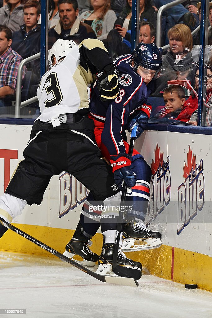 Olli Maatta of the Pittsburgh Penguins pushes Cam Atkinson of the Columbus Blue Jackets against the boards during the third period on November 2 2013...