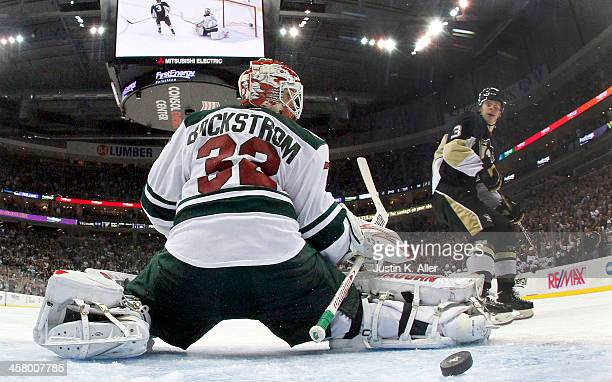 Olli Maatta of the Pittsburgh Penguins scores past Niklas Backstrom of the Minnesota Wild on a penalty shot during the game at Consol Energy Center...