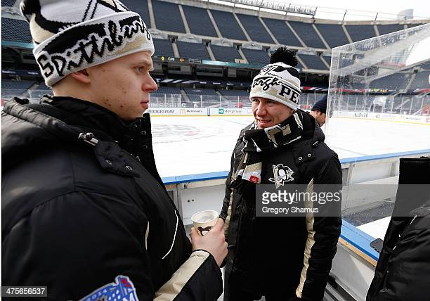 Olli Maatta talks with Jussi Jokinen of the Pittsburgh Penguins during the 2014 NHL Stadium Series practice day on February 28 2014 at Soldier Field...