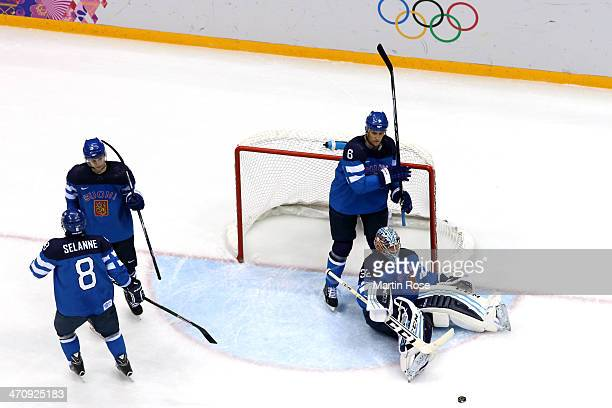 Olli Maatta Teemu Selanne Kari Lehtonen and Sami Salo of Finland look on after a goal in the second period by Sweden during the Men's Ice Hockey...