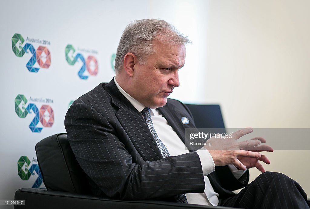 <a gi-track='captionPersonalityLinkClicked' href=/galleries/search?phrase=Olli+Rehn&family=editorial&specificpeople=584845 ng-click='$event.stopPropagation()'>Olli Rehn</a>, economic and monetary affairs commissioner for the European Union (EU), gestures as he speaks during an interview ahead of a Group-of-20 (G-20) Finance Ministers and Central Bank Governors meeting in Sydney, Australia, on Saturday, Feb. 22, 2014. Rehn said in an interview 'it makes sense to set a bold growth target' on the condition that the G-20 final statement agrees on economic reforms and policies that enable reaching that goal. Photographer: Ian Waldie/Bloomberg via Getty Images