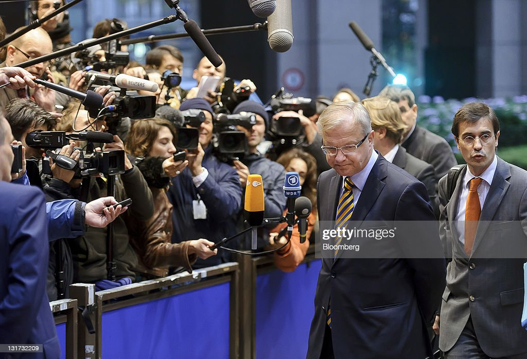 <a gi-track='captionPersonalityLinkClicked' href=/galleries/search?phrase=Olli+Rehn&family=editorial&specificpeople=584845 ng-click='$event.stopPropagation()'>Olli Rehn</a>, The European Union's economic and monetary affairs commissioner, speaks to the media as he arrives for a meeting of Eurogroup finance ministers at the European Council headquarters in Brussels, Belgium, on Monday, Nov. 7, 2011. Luxembourg Prime Minister Jean-Claude Juncker said he expects Greece's new government quickly to affirm its commitment to implementing the terms of a second international bailout. Photographer: Jock Fistick/Bloomberg via Getty Images