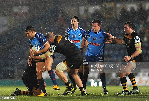 Ollie Barkley of Grenoble is tackled by Tom Lindsay and Jake CooperWoolley of London Wasps during the Amlin Challenge Cup match between London Wasps...