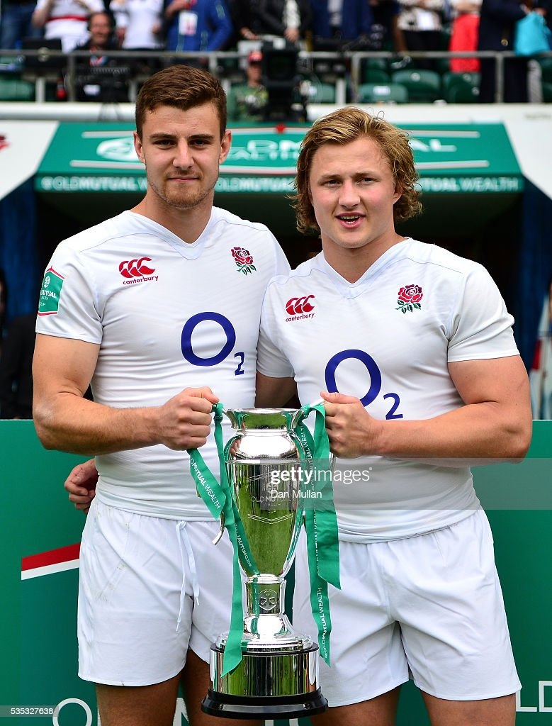 Ollie Devoto and Tommy Taylor of England pose with the Old Mutual Wealth Cup following victory during the Old Mutual Wealth Cup match between England and Wales at Twickenham Stadium on May 29, 2016 in London, England.