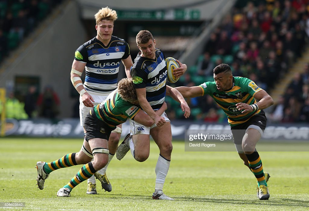 Ollie Devoto of Bath takes on Jamie Gibson (L) and Luther Burrell during the Aviva Premiership match between Northampton Saints and Bath at Franklin's Gardens on April 30, 2016 in Northampton, England.