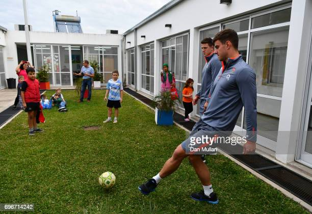 Ollie Devoto of England plays football with patients during a visit to Fundacion Mateo Esquivo a local children's cancer hospital on June 16 2017 in...