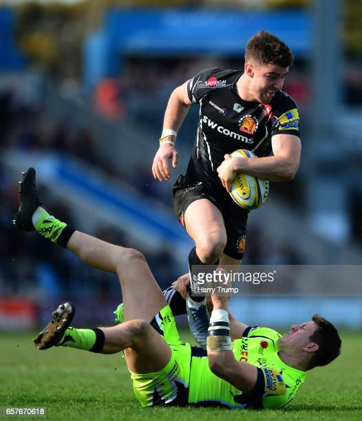 Ollie Devoto of Exeter Chiefs is tackled by Sam James of Sale Sharks during the Aviva Premiership match between Exeter Chiefs and Sale Sharks at...
