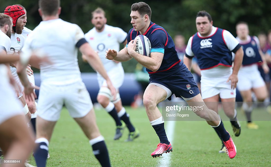 Ollie Devoto runs with the ball during the England training session held at Pennyhill Park on February 4, 2016 in Bagshot, England.