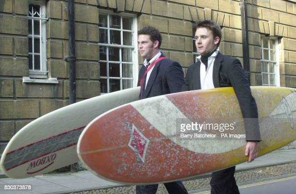 Ollie Dyer and Kevin Richards carry their surfboards after riding on the River Cherwell in Oxford The May Day festivities passed off peacefully with...