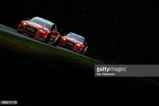 Ollie Jackson of AmDtuning Audi leads from team mate Ant WhortonEales during race one of the British Touring Car Championship finale at Brands Hatch...