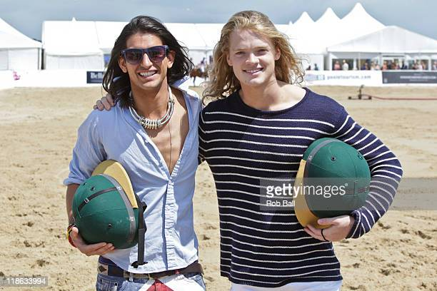 Ollie Locke and Fredrik Ferrier from Made in Chelsea attend the British Beach Polo Championships at Sandbanks Beach on July 9 2011 in Poole England