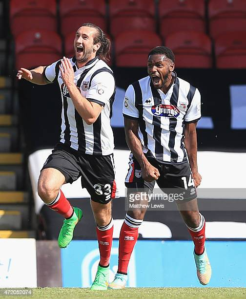 Ollie Palmer of Grimsby Town celebrates scoring a goal with Lenell JohnLewis during the Vanarama Football Conference League match between Grimsby...
