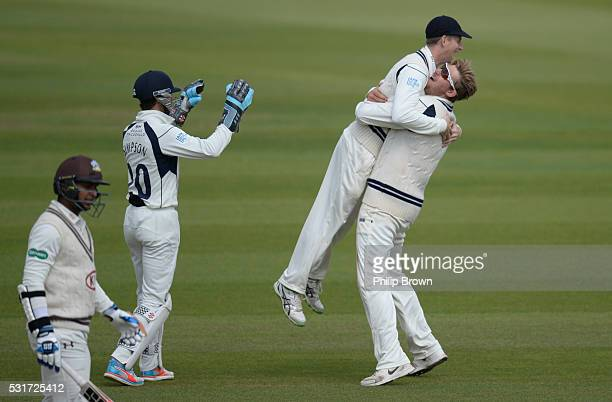 Ollie Rayner of Middlesex celebrates with Adam Voges after dismissing Kumar Sangakkara during day two of the Specsavers County Championship Division...