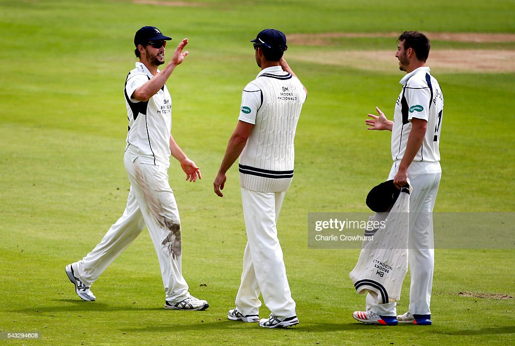 Ollie Rayner (R) of Middlesex celebrates with team mate James Fuller (L) after he takes the catch to dismiss Liam Livingstone of Lancashire during day two of the Specsavers County Championship division one match between Midlesex and Lancashire at Lords on June 27, 2016 in London, England.