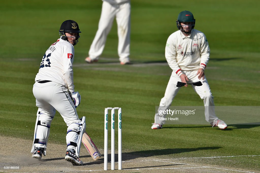 Ollie Robinson of Sussex loses a piece of his helmet after being hit by a ball from Clint McKay of Leicestershire during the Specsavers County Championship Division Two match between Sussex and Leicestershire on May 04, 2016 in Hove, England.
