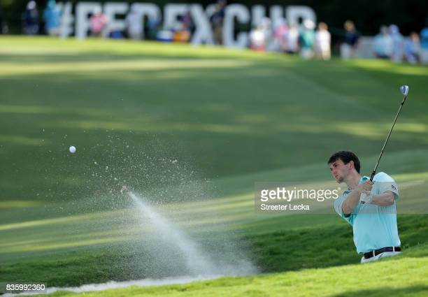 Ollie Schniederjans hits a shot from the sand on the 15th hole during the final round of the Wyndham Championship at Sedgefield Country Club on...