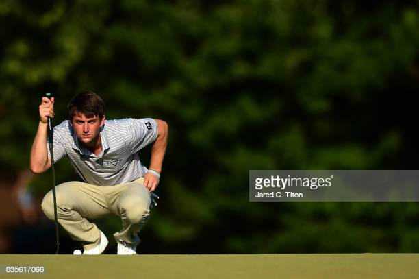 Ollie Schniederjans lines up a putt on the 18th green during the third round of the Wyndham Championship at Sedgefield Country Club on August 19 2017...