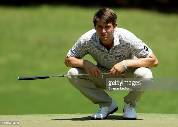 Ollie Schniederjans lines up a putt on the first hole during the third round of the Wyndham Championship at Sedgefield Country Club on August 19 2017...