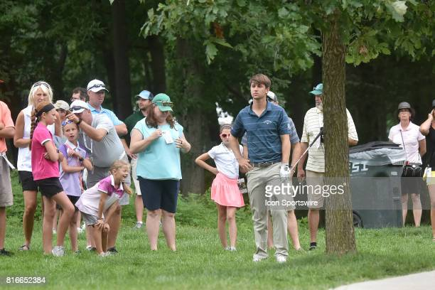 Ollie Schniederjans ponders how best to hit his second shot from the rough on the No 2 hole during the final round of the John Deere Classic July 16...