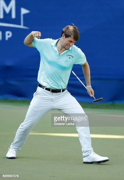 Ollie Schniederjans reacts after making a putt on the 17th hole during the final round of the Wyndham Championship at Sedgefield Country Club on...