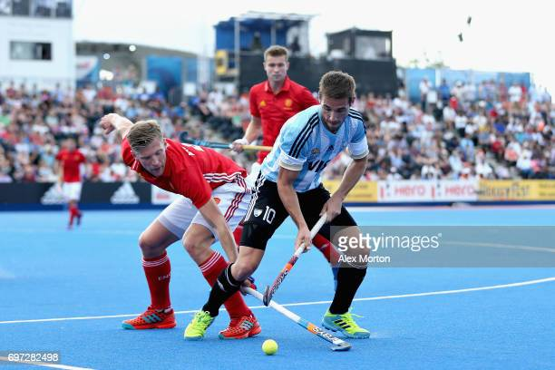 Ollie Willars of England tangles with Matias Paredes of Argentina during the Hero Hockey World League Semi Final match between England and Argentina...