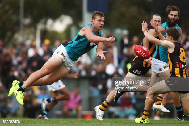 Ollie Wines of the Power passes the ball during the JLT Community Series match between the Port Adelaide Power and the Hawthorn Hawks at Hickinbotham...