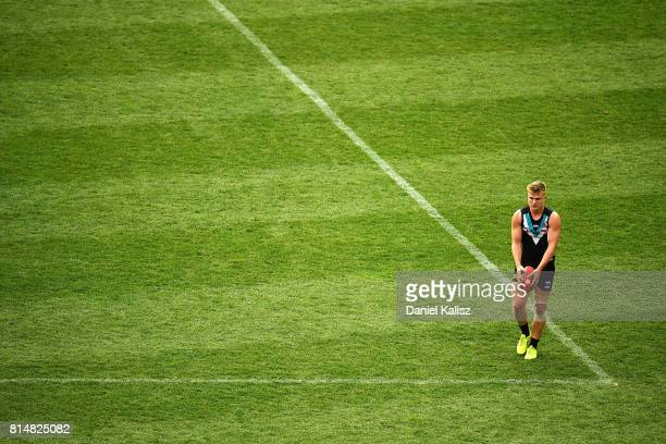 Ollie Wines of the Power prepares to kick for goal during the round 17 AFL match between the Port Adelaide Power and the North Melbourne Kangaroos at...