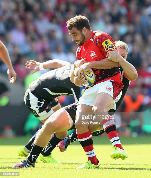 Olly Barkley of London Welsh is tackled during the Aviva Premiership match between London Welsh and Exeter Chiefs at the Kassam Stadium on September...